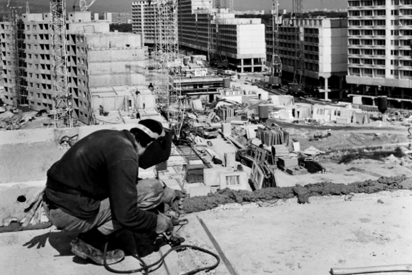 A construction worker is one of many working on the development of yet-to-be the largest neighbourhood in Slovakia, Petržalka, back in the 1970s.