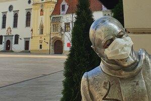 Empty Hlavné námestie (Main square) in Bratislava with statue of Schöner Náci