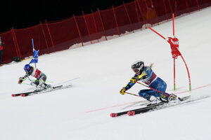 United States' Paula Moltzan, right, and Slovakia's Petra Vlhová speed down the course during the final of an alpine ski women's World Cup parallel giant slalom in Lech/Zuers, Austria.