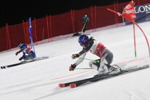 Slovakia's Petra Vlhová and Adriana Jelinkova of the Netherlands compete during the parallel giant slalom in Lech/Zuers, Austria.
