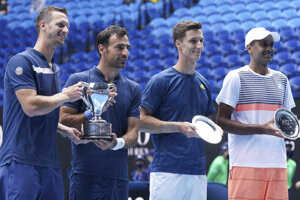 Slovakia's Filip Polasek, left, and Croatia's Ivan Dodig, second left, pose with their trophy after defeating Rajeev Ram, right, of the US and Britain's Joe Salisbury in the men's doubles final at the Australian Open tennis championship in Melbourne, Australia, Sunday, Feb. 21, 2021.