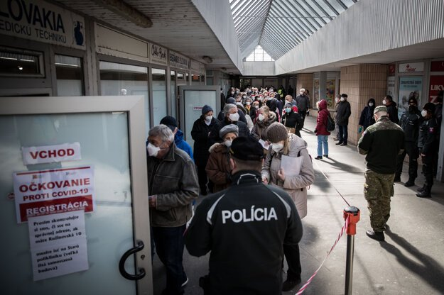 Tens of pensioners registered to be given a Covid-19 vaccine jostled in front of the University Hospital in Bratislava's Ružinov on March 11.