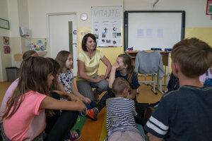 Iveta Barková with her students.