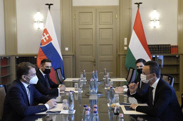 Hungarian Minister of Foreign Affairs and Trade Péter Szijjártó (r) and Slovak Finance Minister Igor Matovič (l) talk during their meeting at the Ministry of Foreign Affairs and Trade in Budapest, Hungary, Friday, April 9.