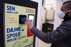 A customer recycles a plastic bottle in the first automatic bottle and can bank vending machine in Slovakia, launched in the town of Senec on April 19.
