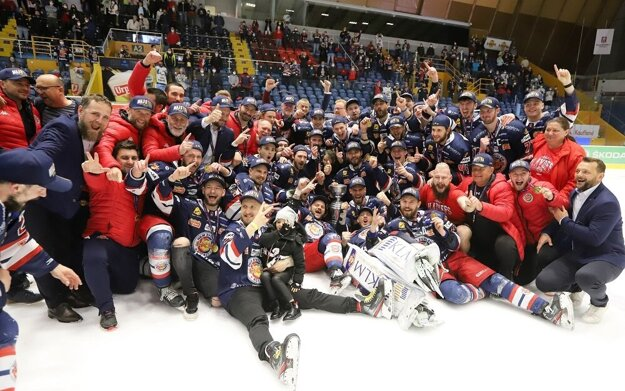The HKM Zvolen ice hockey team poses for the traditional team shot after defeating HK Poprad and winning the championship trophy in the 2020/2021 season.