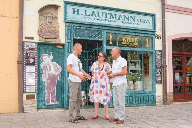 Juraj Karniš (left) and Kroner's daughter, Zuzana, who herself is a famous actress, stand in front of one of the stops on the Walk of The Shop on Main Street in Sabinov, where Karniš' statue should be installed.