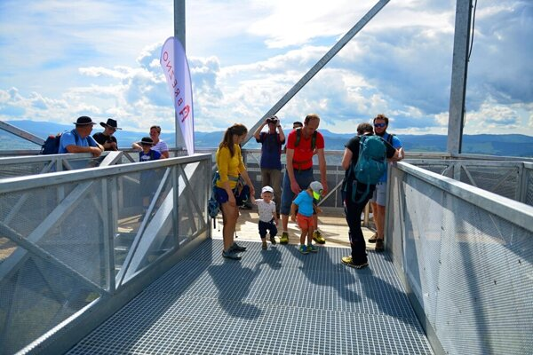 Visitors to the newly opened lookout tower outside Brezno enjoy the views of hills surrounding the town.
