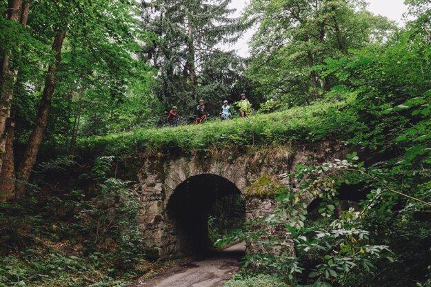 Cyclists stand on the bridge in the Pokutská Dolina valley, Žarnovica, central Slovakia.