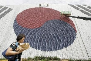 Seoul City Hall, pictured covered by a South Korean national flag made of about 27,000 plastic balls, in August 2008. The flag was made to commemorate Liberation Day on August 15.