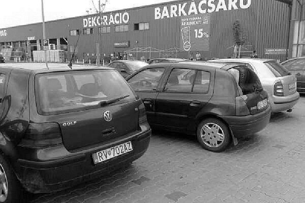 Slovak-registered cars parked at a store in Hungary
