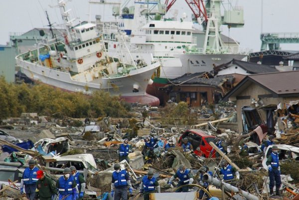 Soldiers and firefighters search for the victims in the rubbles on March 14 in Matsushima, Miyagi Prefecture, Japan, three days after northeastern coastal towns were devastated by an earthquake and tsunami.