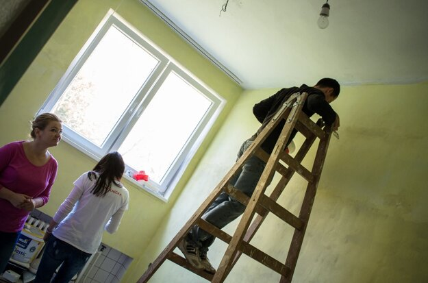Painting rooms in a facility for children and adults with mental disabilities.