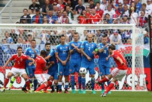 Wales's Gareth Bale, right, shoots a free kick to score the opening goal during the Euro 2016 Group B soccer match between Wales and Slovakia, at the Nouveau stadium in Bordeaux, France, Saturday, June 11, 2016.
