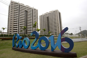 The Rio 2016 sign stands in front of the Olympic Village in Rio de Janeiro, Brazil.