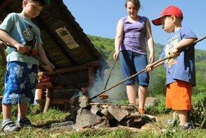 """Ready to roast a Slovak """"špekáčik"""" using the traditional wooden stick."""