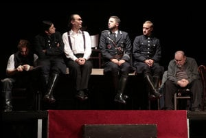 The Hearing by Aréna Ostrava Chamber Theatre explores the role and perosnality of Adolf Eichmann (white shirt, centre).