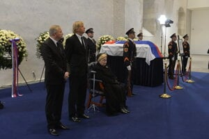 The family of Michal Kováč receives condolences. His wife Emília is accompanied by their two sons, Michal Jr (left), and Juraj.