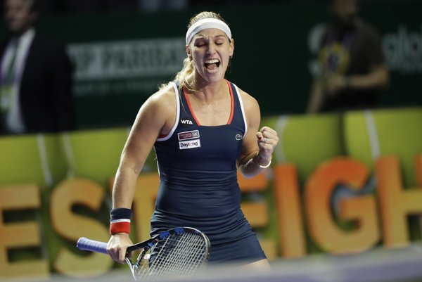 Dominika Cibulková celebrates winning ball during the match against Simona Halep at the 2016 WTA Tour world championship in Singapore.