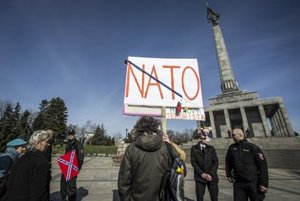 Some peple gathered at Slavin in Bratislava brought ani-NATO banners.