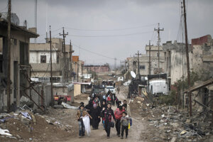 Iraqi civilians flee their homes during fighting between Iraqi security forces and Islamic State militants, on the western side of Mosul, Iraq, in March 2017.