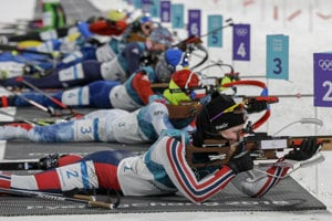 Female biathletes shoot the first round of pursuit 10-km race.