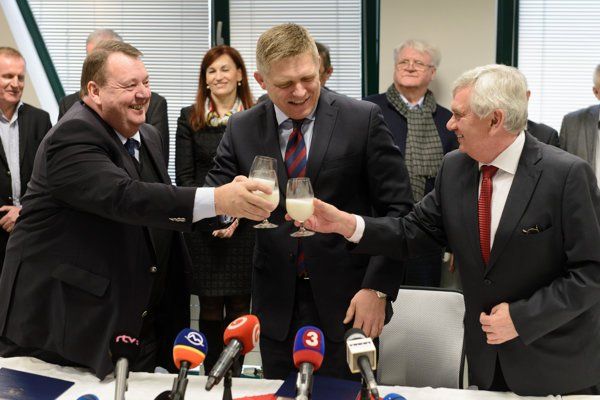 Representative of Midia Agro Norman Patrick Turner, MP Robert Fico and Agriculture Minister Ľubomír Jahnátek, from left, touch glasses of milk after signing the memorandum.