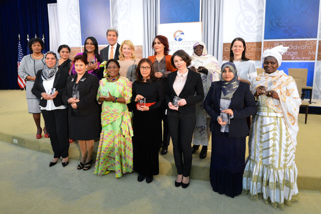 US Secretary of State John Kerry and US Ambassador-at-Large for Global Women's Issues Cathy Russell pose for a photo with the 2016 Secretary of State's International Women of Courage Award winners at the U.S. Department of State in Washington, D.C., on March 29, 2016.