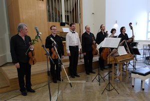 Organiser and organist Marke Vrábel (C) with Musica Aeterna