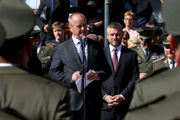 Defence Minister Peter Gajdoš (foreground) and PM Peter Pellegrini attend a ceremony together