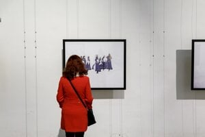 A visitor to the 2017 Month of Photography festival in Bratislava looks at a photo by Polish photographer Dominika Gesicka
