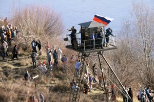About 50,000 attended the march from Bratislava to Hainburg in Austria, a symbolic end of the Iron Curtain,on Dec 10.
