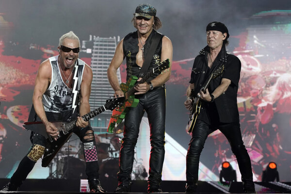 Rudolf Schenker, from left, Matthias Jabs and Klaus Meine, of the band Scorpions perform at the Rock in Rio music festival in Rio de Janeiro, Brazil, early Saturday, Oct. 5, 2019.