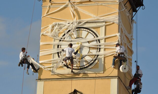 A group of men tries to achieve a record in wrapping Banská Bystrica's clock tower in toilet paper on June 12, 2009, celebrating 180 years since the start of paper production at the SHP Harmanec company