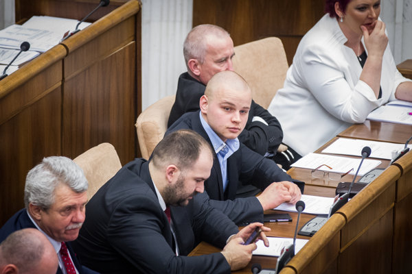 MP Milan Mazurek (centre)