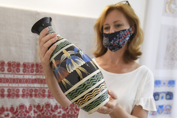 Director of the ÚĽUV regional craft centre in Košice, Júlia Jeleňová, with Pozdišovce ceramics.