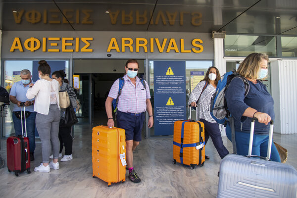 Passengers arrive at Nikos Kazantzakis International Airport in Heraklion, on the island of Crete, Greece.