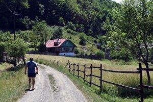 A man walks along a road in the Kýčera settlement in the Kysuce region.