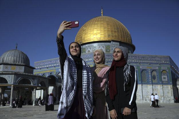 Women pose for a selfie in Jerusalem.