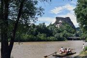 Tourists raft on the Orava river in the village of Oravský Podzámok, which is home to Orava Castle.
