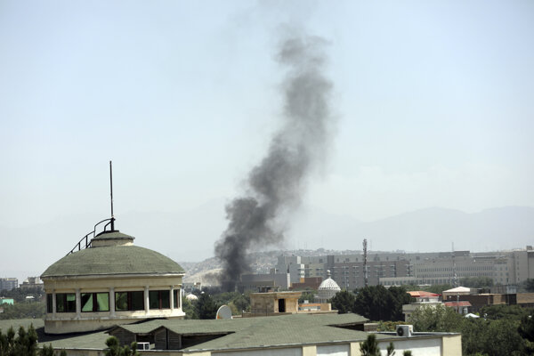 Smoke rises next to the US Embassy in Kabul, Afghanistan, on Sunday, August 15, 2021. Taliban fighters entered the outskirts of the Afghan capital on Sunday, further tightening their grip on the country as panicked workers fled government offices and helicopters landed at the embassy.