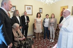 Pope Francis meets with the recalled archbishop Robert Bezák and his family.