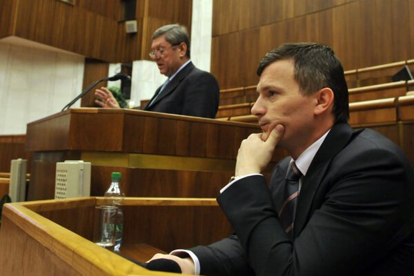 Finance Minister Počiatek attending a parliamentary session on the state budget.