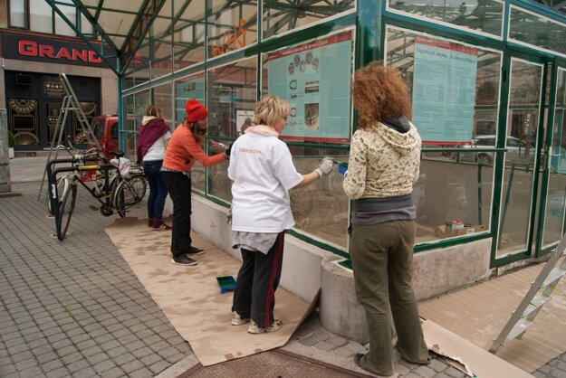 Painting St James' Chapel glasshouse.