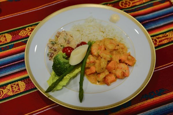 Shrimp and pumpkin, served with rice and vegetables.