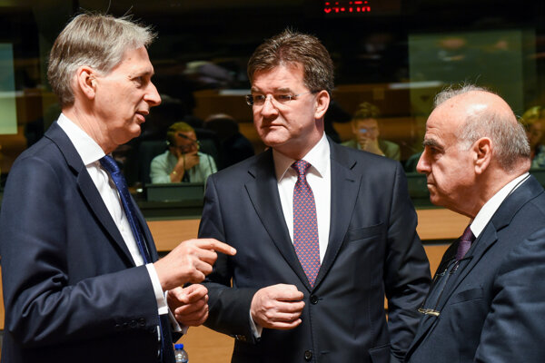 British Foreign Minister Philip Hammond, left, speaks with Slovakia's Foreign Minister Miroslav Lajčák, middle, and Malta's Foreign Minister George Vella during a meeting of EU foreign ministers at the EU Council building in Luxembourg, on June 20.