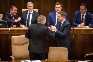 Deputy speakers of parliament Andrej Hrnčiar and Béla Bugár (both Most-Híd), PM Robert Fico (Smer), Speaker of Parliament Andrej Danko (SNS), Finance Minister Peter Kažimír (Smer) and Deputy Speaker of Parliament Martin Glváč (Smer), from left, after parliament adopted the state budget.