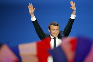 Emmanuel Macron rejoices after the first round of French presidential election