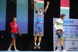 Sagan (C) rejoices over his third champion title, with Kristoff (NOR) and Mathews (AUS) showing much less enthusiasm.