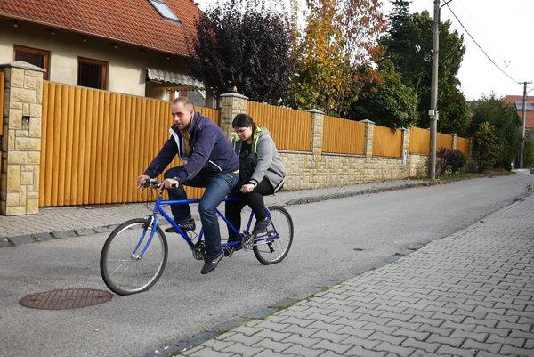 Alžbeta Poláková on tandem bicycle.